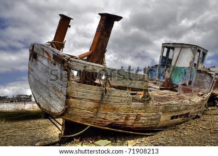 Shipwreck on a beach. - stock photo