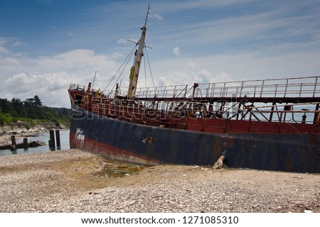 Shipwreck on Black sea coast. Ship brought ashore.