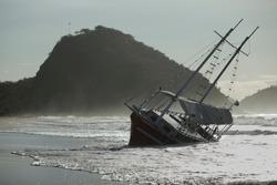 Shipwreck, sailing vessel aground, after storm at Copacabana beach, Rio de Janeiro, Brazil