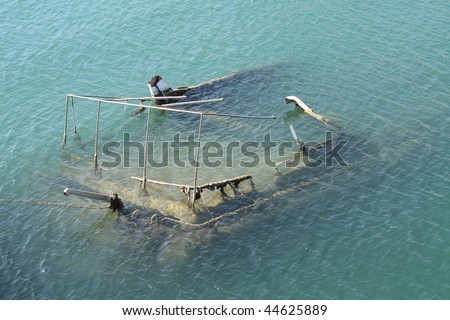 Shipwreck sunk in Mediterranean waters in Pireas near Athens, Greece. - stock photo