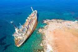 Shipwreck. The ship ran aground the top view. The ship crashed on the coastal cliffs. Abandoned marine vessels. The ship lies on the tank view from the drone.