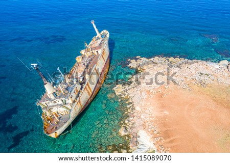 Shipwreck. The ship ran aground the top view. The ship crashed on the coastal cliffs. Abandoned marine vessels. The ship lies on the tank view from the drone. #1415089070