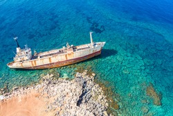 Shipwreck view from drone. The merchant ship sank. Marine catastrophe. The ship ran aground the top view.  Abandoned marine vessels. Ocean from above. Mediterranean Sea. Turquoise water.
