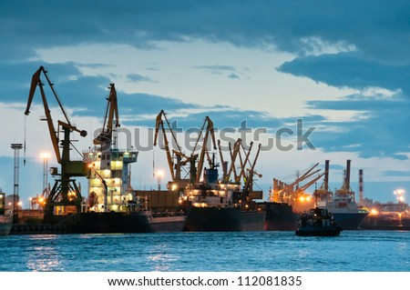 Shipyard with ships at dusk time with beautiful cloudscape