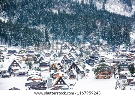 Shirakawa-go is village famous with snow in the winter for Gassho-zukuri (houses with steep thatched roofs) in Gifu prefecture, Japan #1167959245