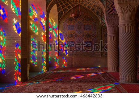 SHIRAZ, IRAN - May 3, 2016:  Nasir al Molk or Pink Mosque in Shiraz, Iran. The stained glass windows produce a colourful effect on the carpets, columns and walls in the morning.