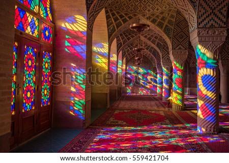 SHIRAZ, IRAN - OCTOBER 23, 2016 : Colorful light through stained glass window inside Nasir Al-Mulk Mosque (Pink Mosque), a traditional mosque in Shiraz, Iran.