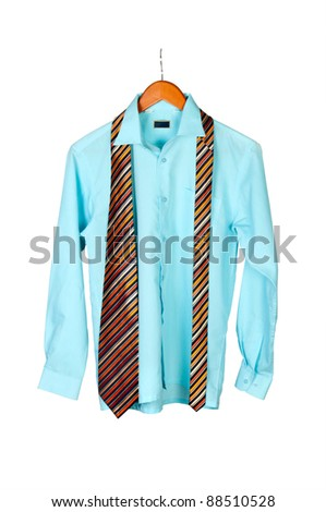 shirt and tie on hanger isolated in white background