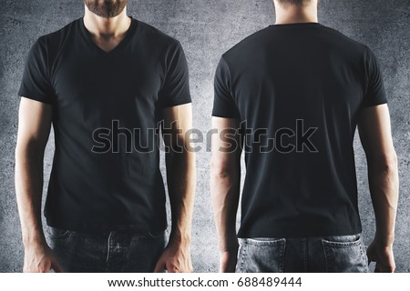 Shirt design and people concept. Close up of male in blank black t-shirt front and rear view. Clean empty mock up template for your design. Concrete background #688489444