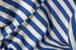 Shirt having a color in the form of alternating horizontal white stripes and stripes of a different color. Striped body shirts are worn by military and civilian sailors of France, Russia and others.