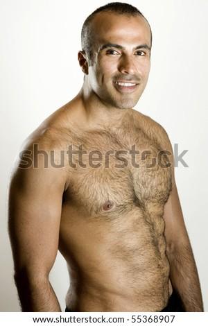 Shirtless hispanic man