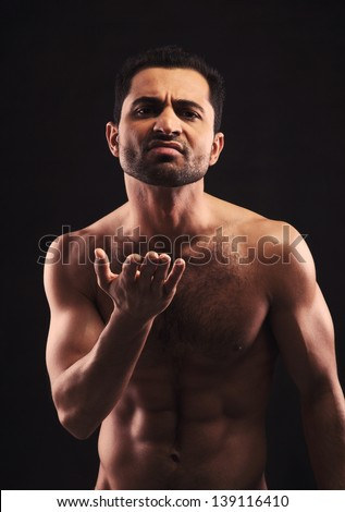 Shirtless man gesturing and wanting to start a fight
