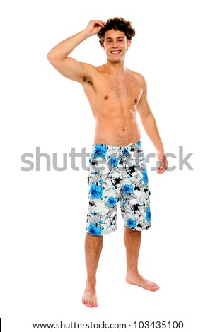 Shirtless muscular guy in swimming costume isolated against white background