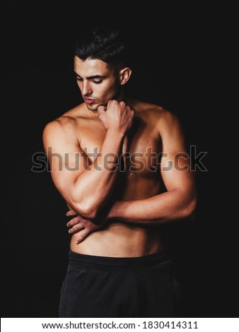 shirtless muscular man on a black background Stock photo ©