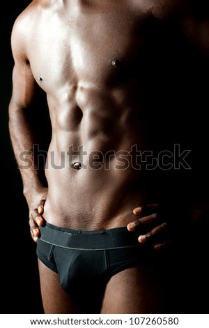Shirtless underwear male model posing in style. Hands on waist, cropped image