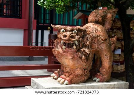 Shisa ( male ) - A traditional Ryukyuan cultural artifact and decoration at Naminoue Shrine, Okinawa, Japan