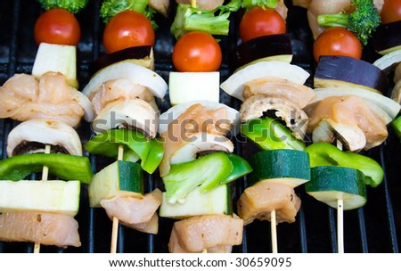 Shish-kabobs on a barbecue.