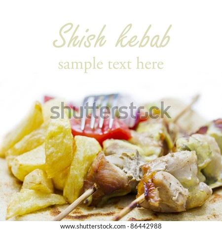 shish kebab(greek souvlaki) with fried potato and salad with place for your text - stock photo