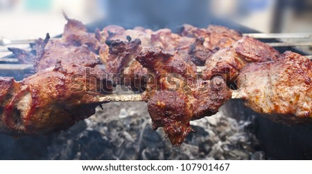 Shish kebab on skewers in a charcoal grill