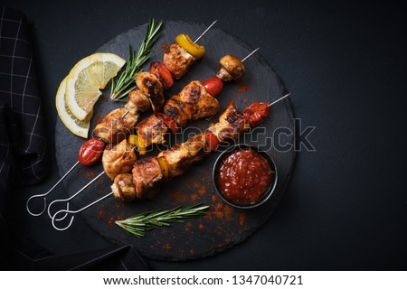 Shish kebab with mushrooms, cherry tomato and sweet pepper, Grilled meat skewers. Top view, copyspace.