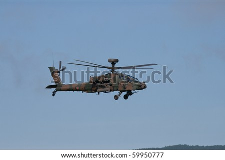 SHIZUOKA, JAPAN - AUGUST28: Japanese Self Defense Force AH-64 Apache attack helicpoter during the Fire Power display near Mount Fuji August 28 2010 in Shizuoka, Japan.