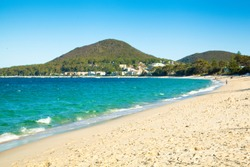 Shoal Bay beach Port Stephens Australia landscape view with beach, ocean and distant town and mountain views