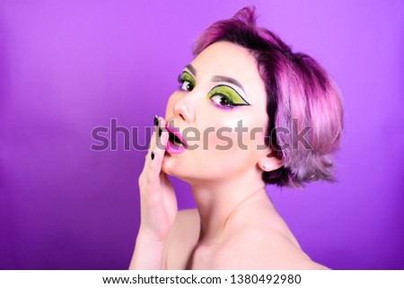 Shock reaction. Sexy girl with short hair. Portrait of a woman with bright colored hair, all shades of purple. Beautiful lips and makeup. . Professional coloring. professional makeup.