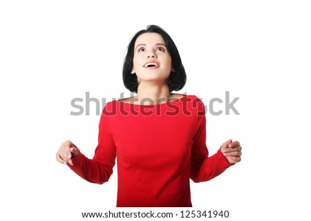 Shocked and excited woman looking up, isolated on white