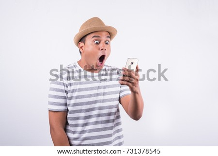 Shocked and surprised asian man looking smartphone