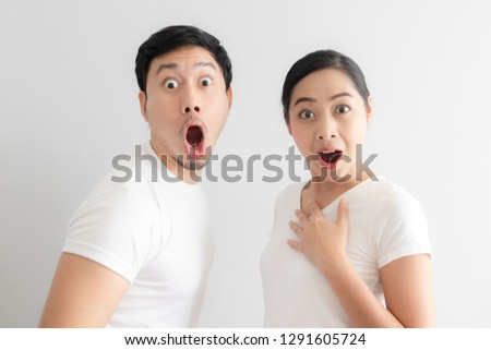 Shocked and surprised face of Asian couple lover in white t-shirt.