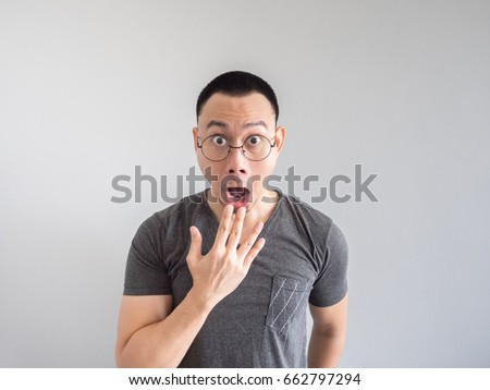 Shocked and surprised freelance Asian man with funny face. #662797294
