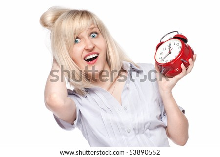 Shocked beautiful young woman with alarm clock isolated on white