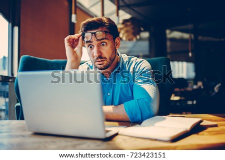 Shocked businessman getting off eyeglasses can't believe in low company income reading documents.Stressed entrepreneur doubting in receipt numbers worried about paying debt checking banking account