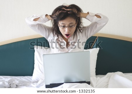 Shocked businesswoman in bed