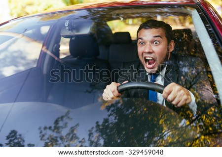shocked driver in the car