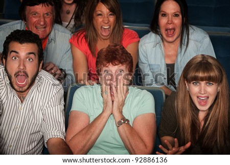 Shocked group of 7 people in theater