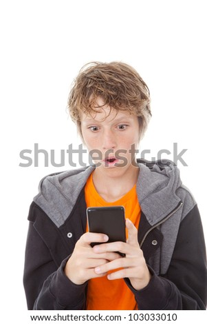 shocked kid reading message on mobile or cell phone