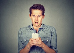 Shocked man checking his mobile phone