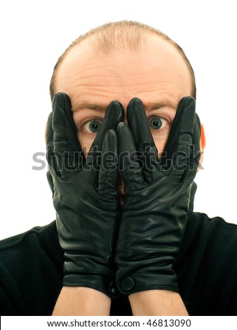 Shocked man closing face with hands isolated on white background