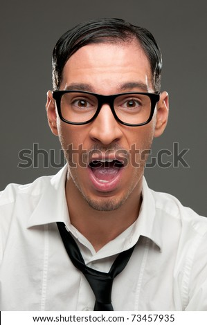 Shocked nerd with open mouth looking at camera