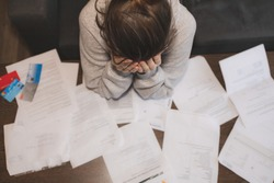 Shocked stressed young woman reading document letter from bank about loan debt financial problem, frustrated worried about bills notification, troubled with bad news or failed test results in mail