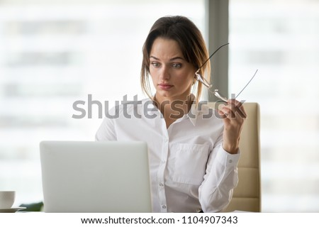Shocked surprised businesswoman amazed by reading unbelievable online breaking news on laptop, astonished woman feels stunned dumbfounded looking at computer screen baffled by unexpected email letter Stock foto ©