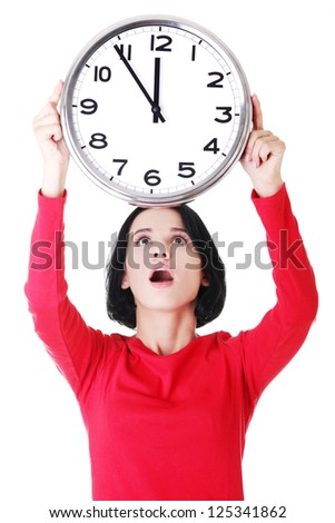 Shocked woman holding office clock, isolated on white bacvkground