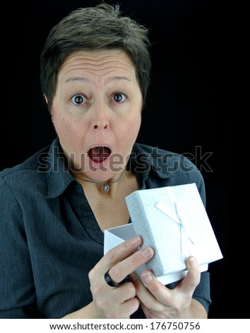 shocked woman opening a surprise present in gift box