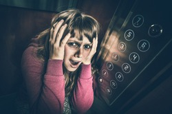 Shocked woman with claustrophobia in the moving modern elevator - retro style