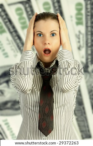 Shocked young business woman over a hundred-dollar notes background.