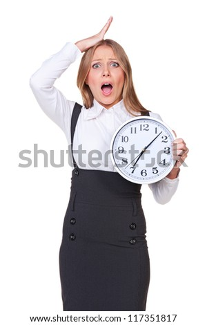 shocked young businesswoman holding the clock. isolated on white background
