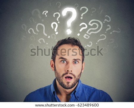 Shocked young man with many questions and no explanation or answer