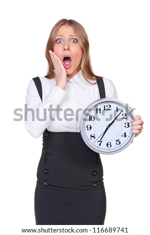 shocked young woman holding the clock. isolated on white background
