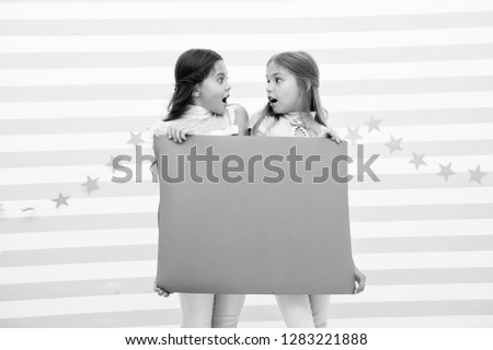 Shocking announcement concept. Amazing surprising news. Girl hold advertising banner. Girls kids holding paper banner for announcement. Shocked surprised children with blank paper copy space. #1283221888